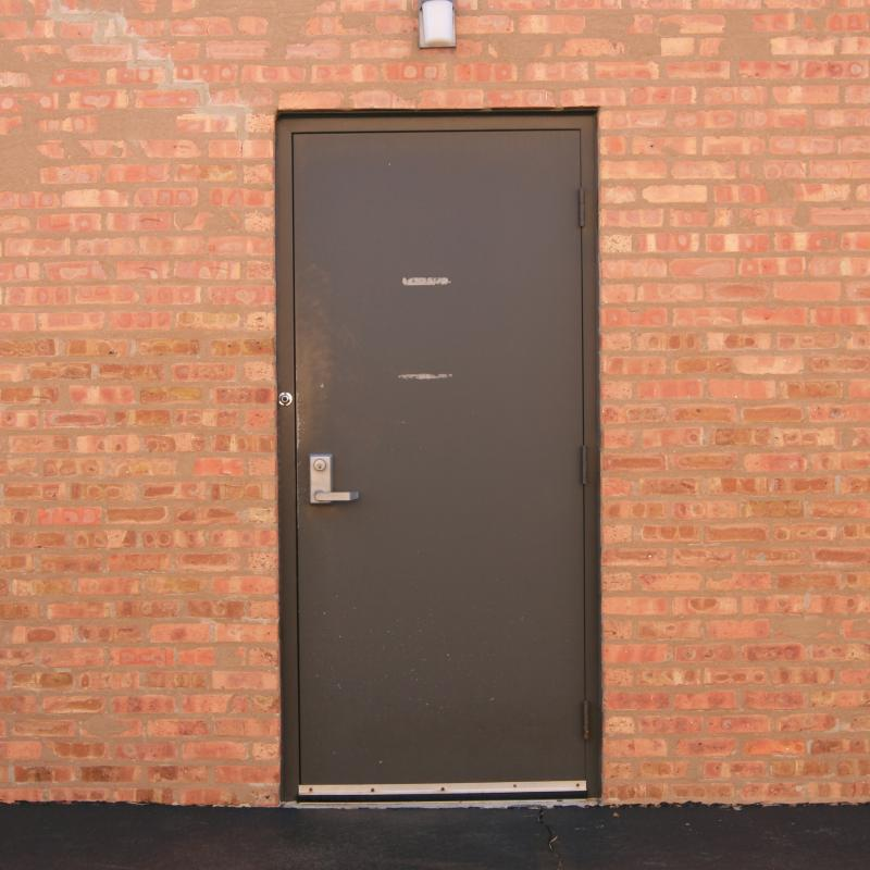 Heavy steel exterior pedestrian door