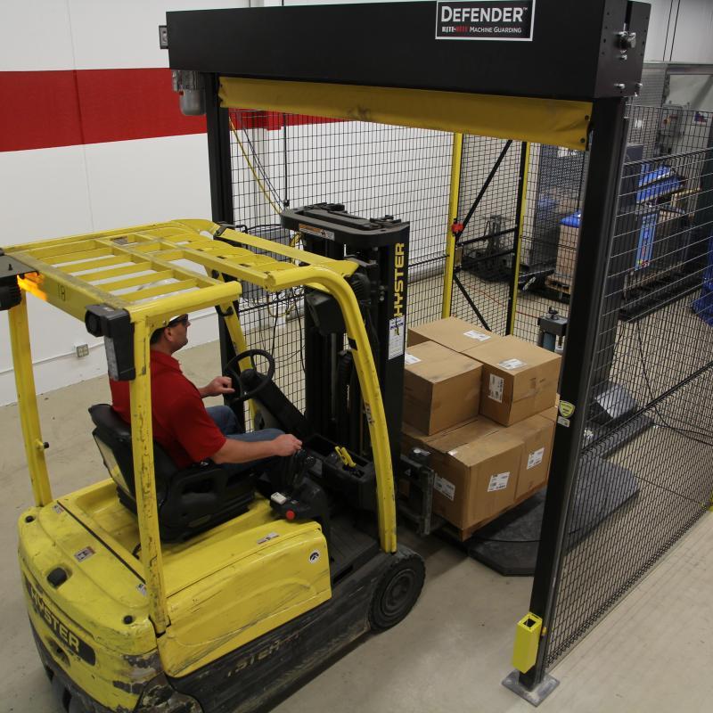 Forklift entering the Defender Cell cage