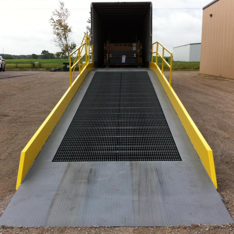 Mobile Yard Ramp leading up to the back of an open trailer