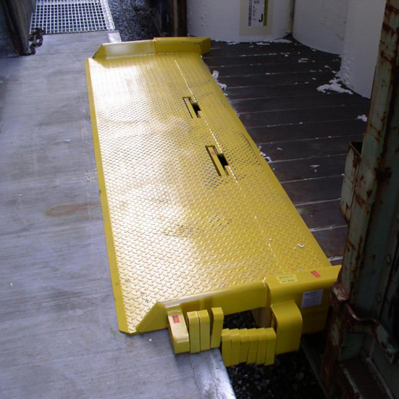 Portable Railboard bridges the gap between the Loading Dock and the trailer bed