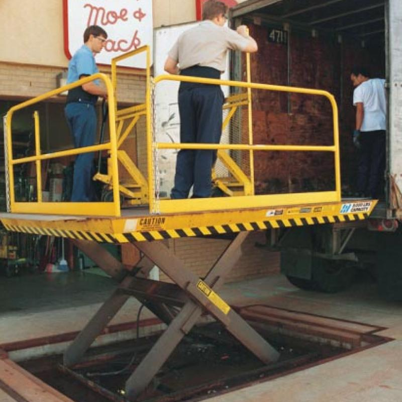 Scissor Lift raises employees into trailer bed