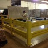 GuardRite Steel providing area protection for warehouse worker