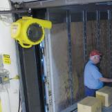 CoolMan Dock Fan positioned into trailer bed during unloading