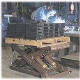 Scissor Lift table holding metal equipment