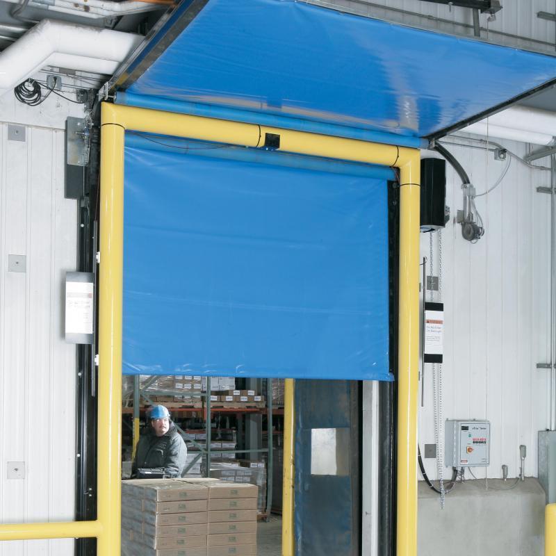 Forklift taveling through FasTrax Cold Storage Door