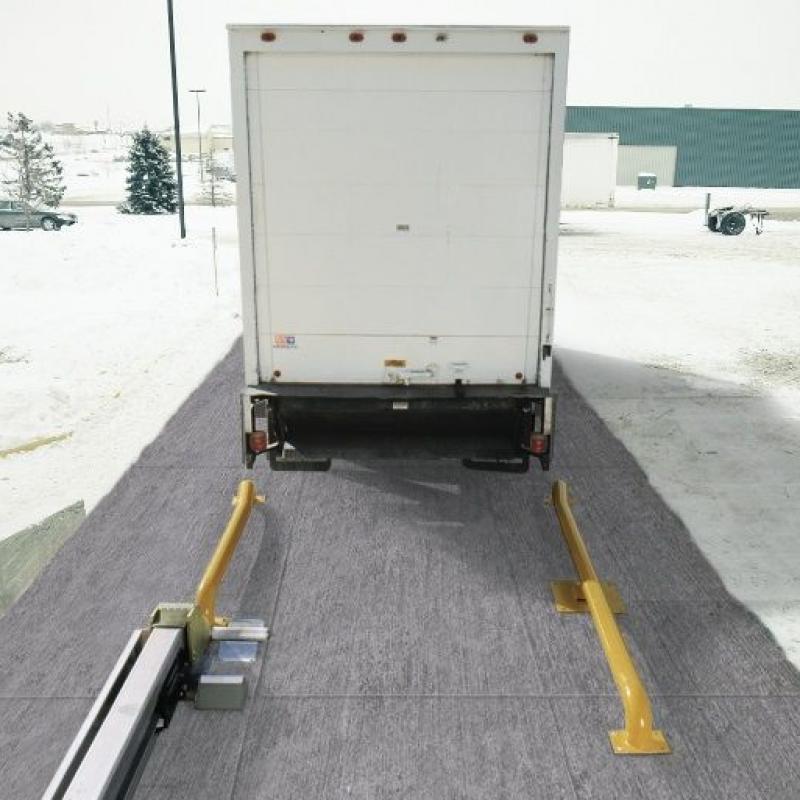 Semi-trailer backing up into the Global Wheel-Lok
