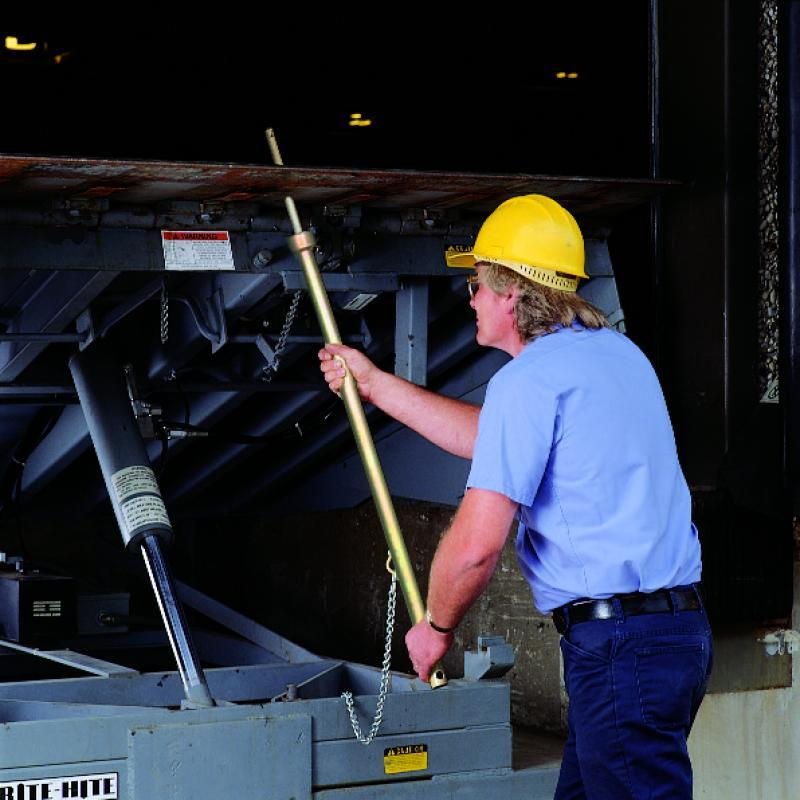 Safe-T-Strut being installed on a dock leveler