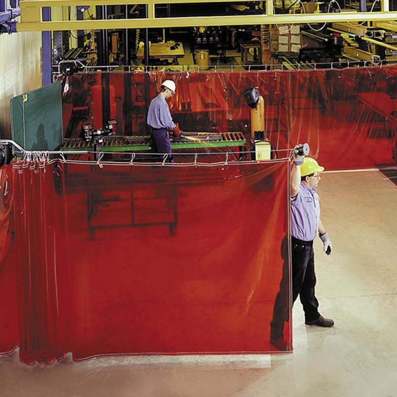 XTen Retractable Safety Barrier Curtain in sue at a warehouse