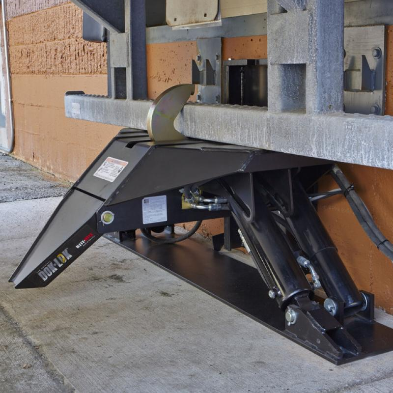 Stabilizing Dok-Lok Vehicle Restraint active at loading dock