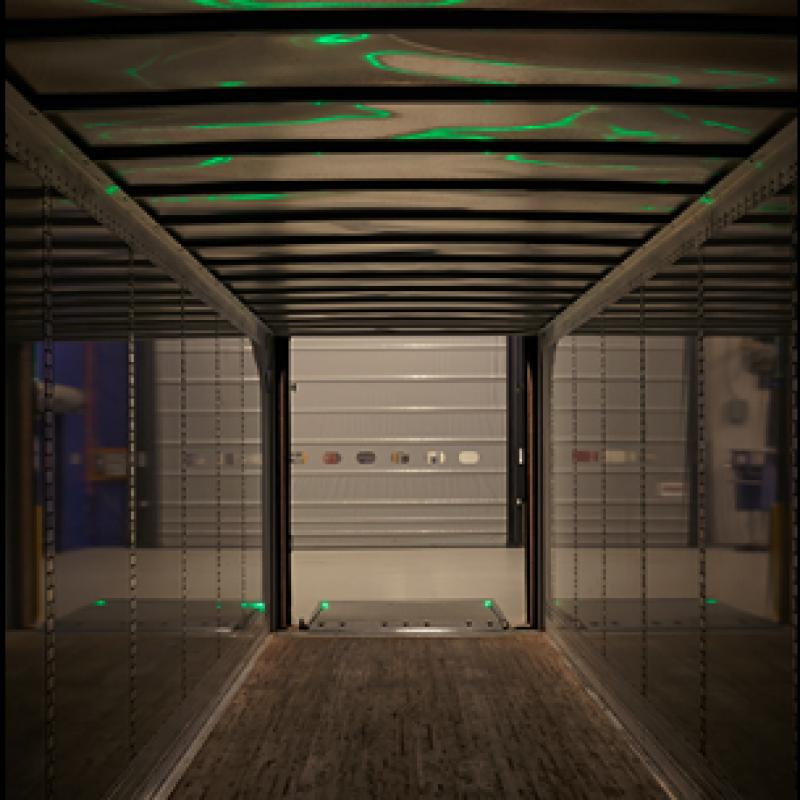 View of green-lit dock Leveler-Vu lights from inside the trailer