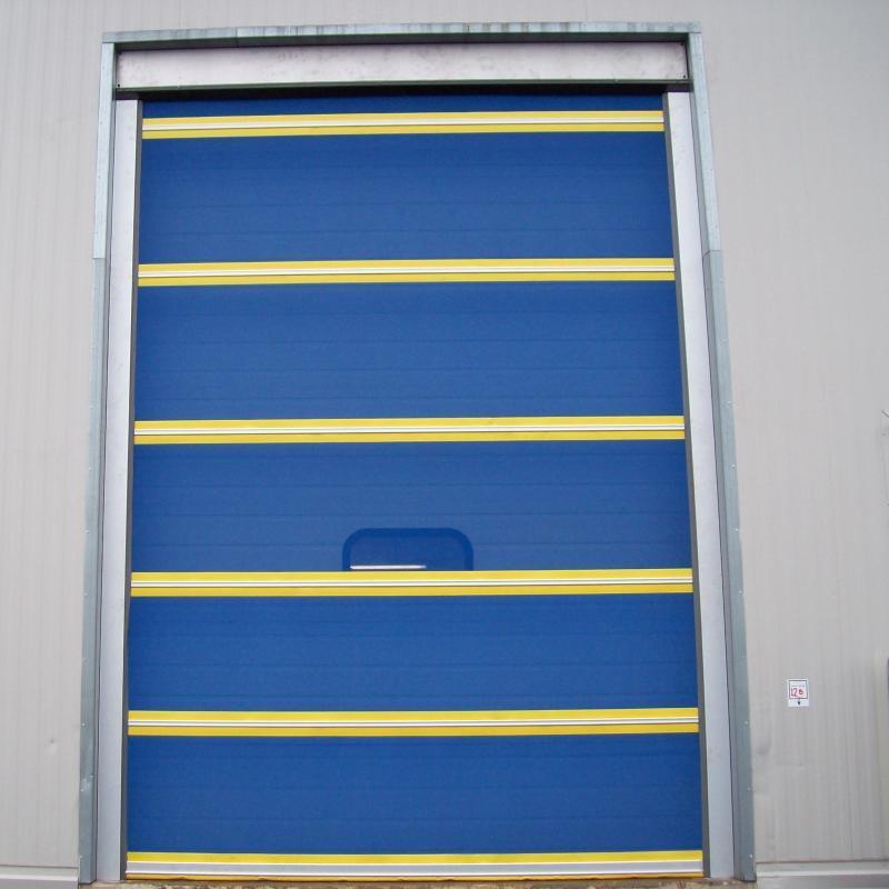 Full-length fabric screen door at loading dock opening