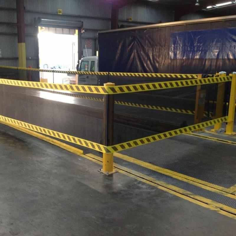 Highly visible SpanGuard Strap Barrier protects open loading dock