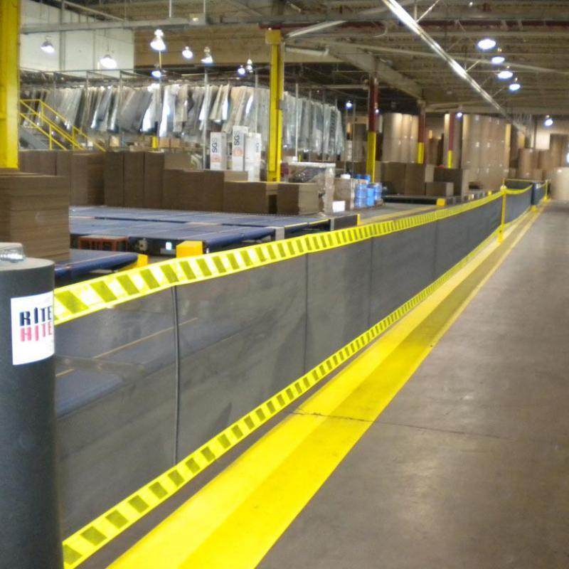 Flexible SpanGuard Strap Barrier System defines warehouse areas