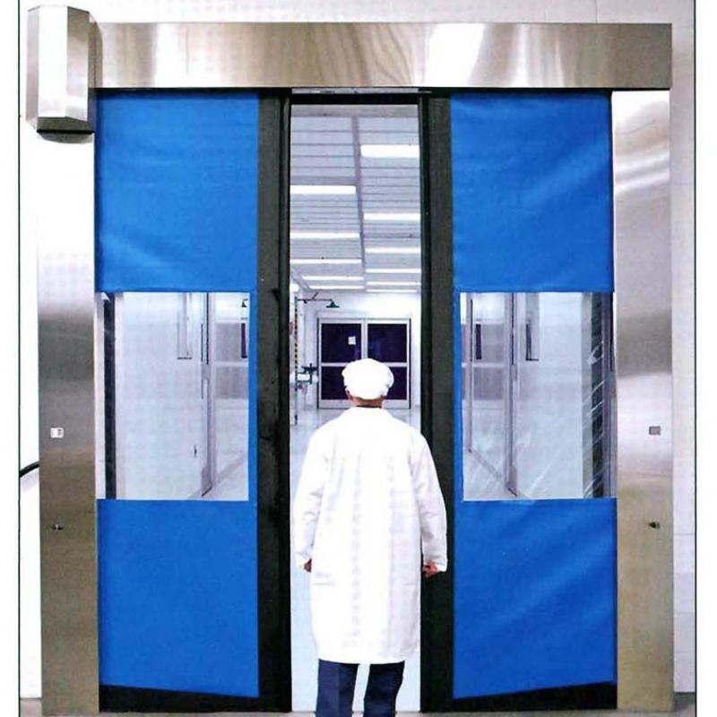 Pharma employee walking through SplitSecond Clean high speed door