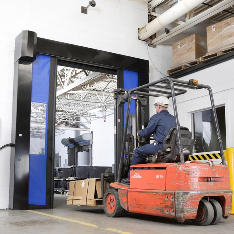 Forklift traveling through two panels of the SplitSecond High Speed Door