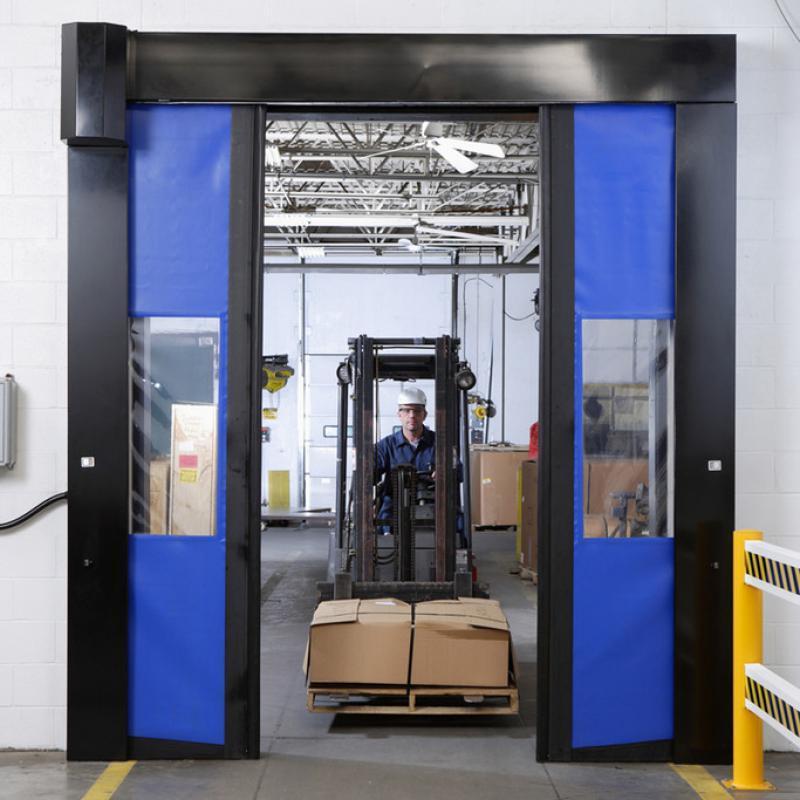 Forklift traveling through SplitSecond High Speed Door