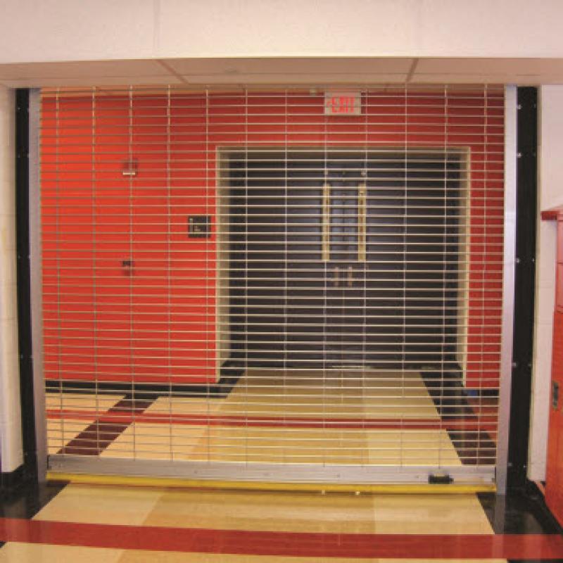 Rolling Grille steel door cage in high school hallway