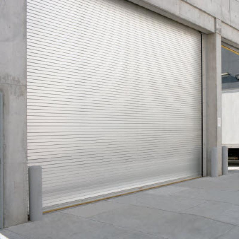 Silver rolling steel door in parking lot