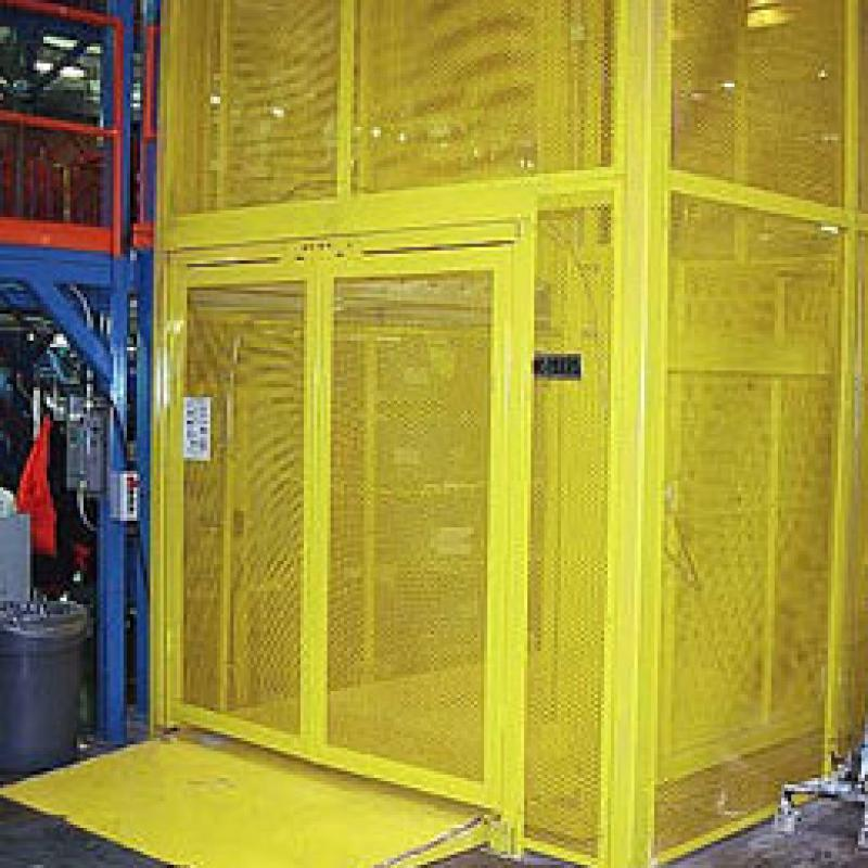 Yellow cage hydraulic freight lift