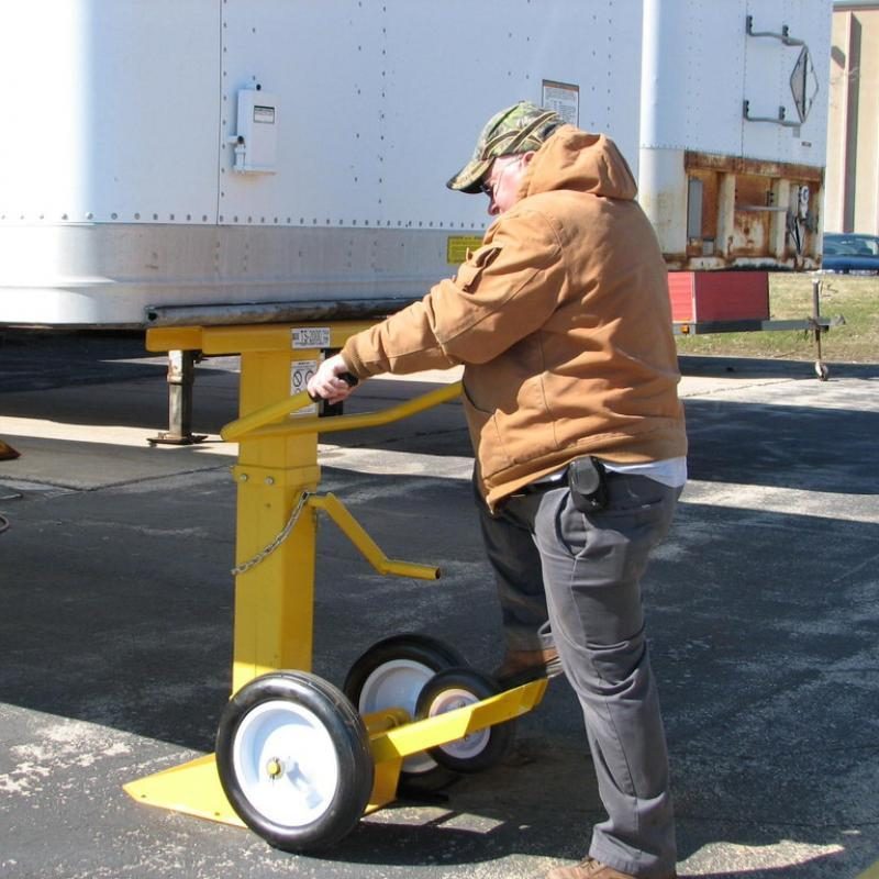 Employee adjusting Trailer Stand placement
