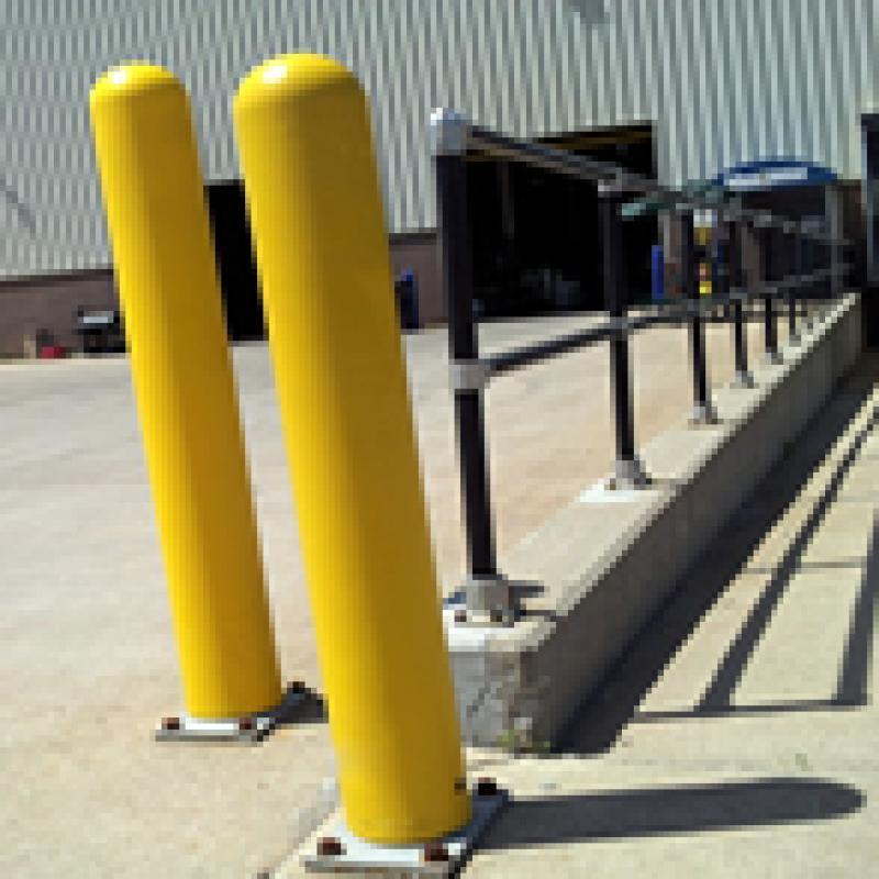 Yellow Bumper Post Sleeves protect cars from tight turns at the loading dock