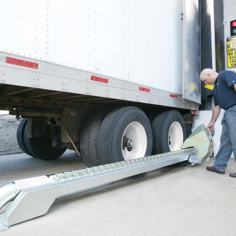 Warehouse employee securing a trailer with the Manual Wheel-Lok