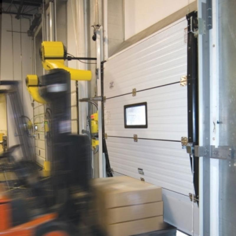 Forklift moving into PxV Impactable Sectional Door