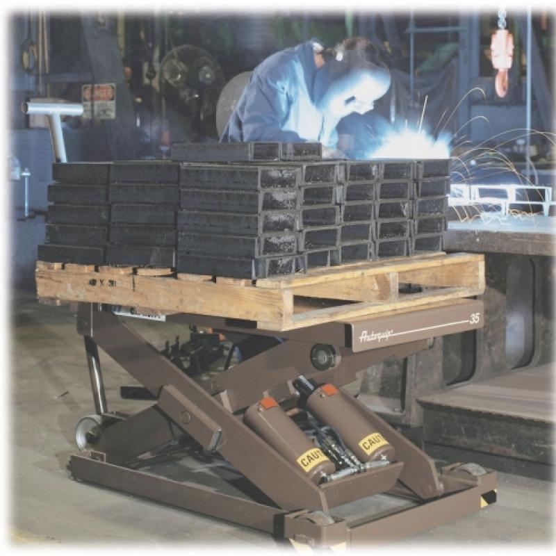Scissor Lift table holding metal equipment
