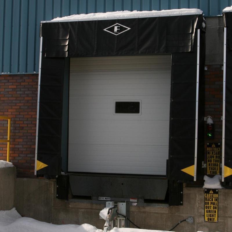 Survivor Dock Shelter installed at snowy loading dock